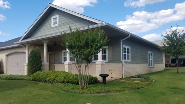 A side view of a typical house with garage at the Retirement Community Parc Place in Bedford, TX