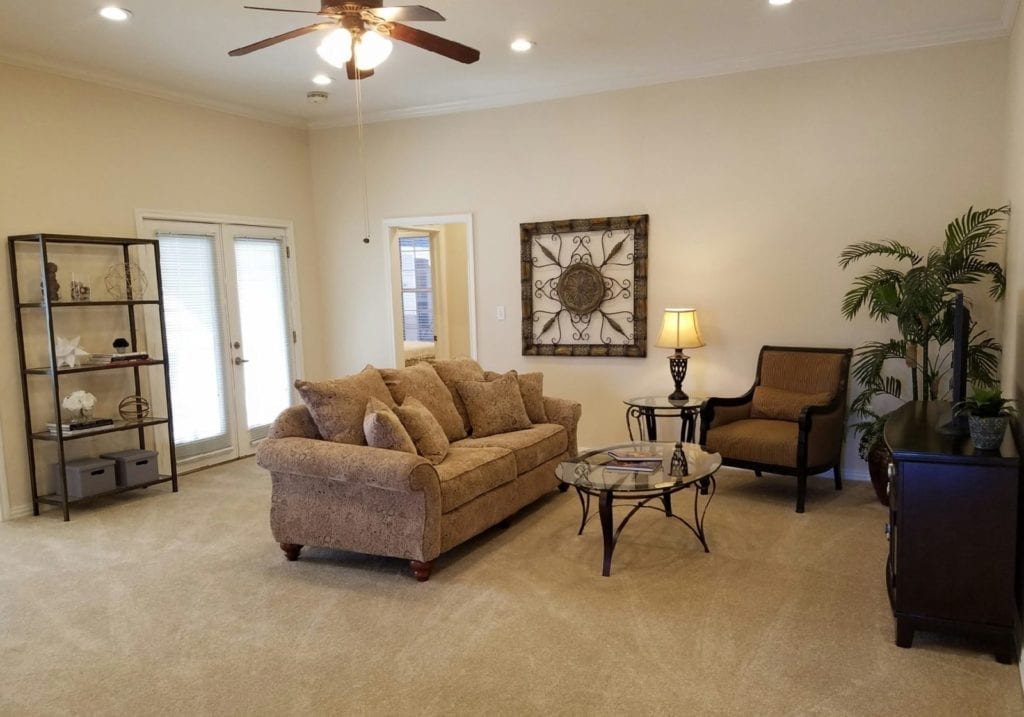 Typical small apartment living room at the Retirement Community Parc Place in Bedford, TX