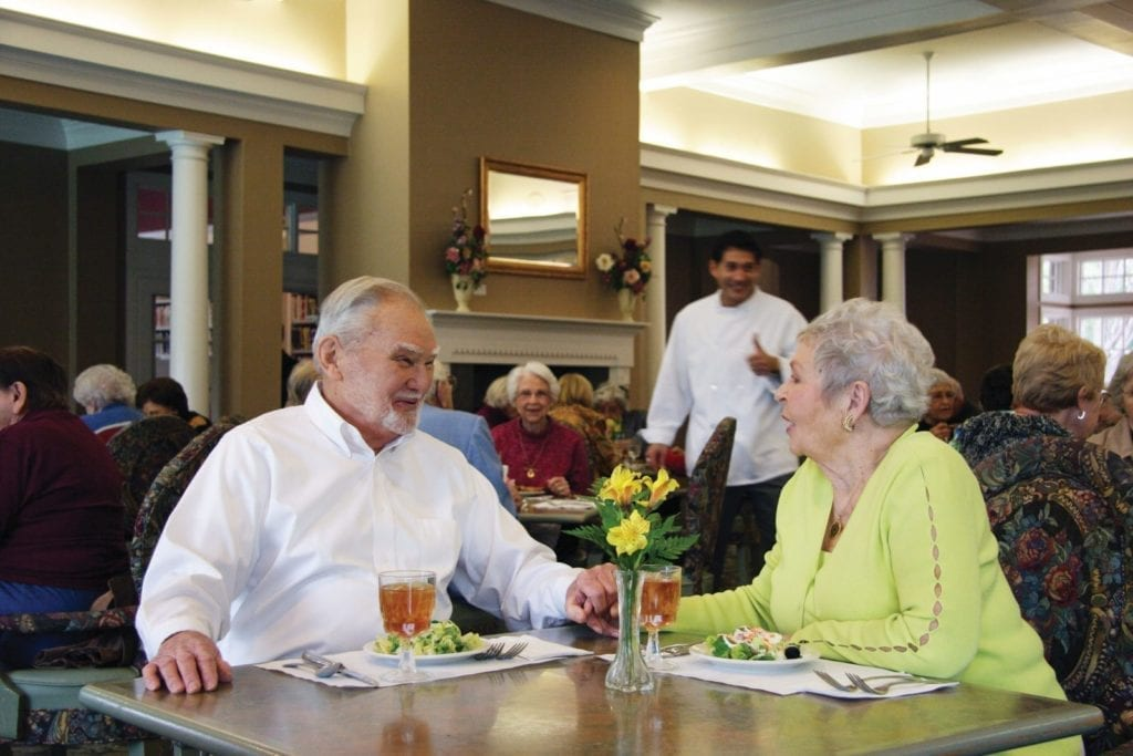 A senior couple having dinner at the Active Adult Community Preston Place in Plano, TX
