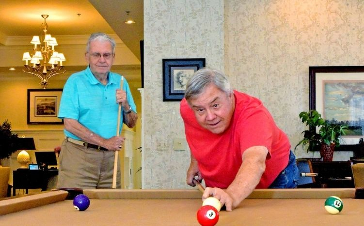 Two senior men playing pool at the Retirement Community Verena at the Reserve