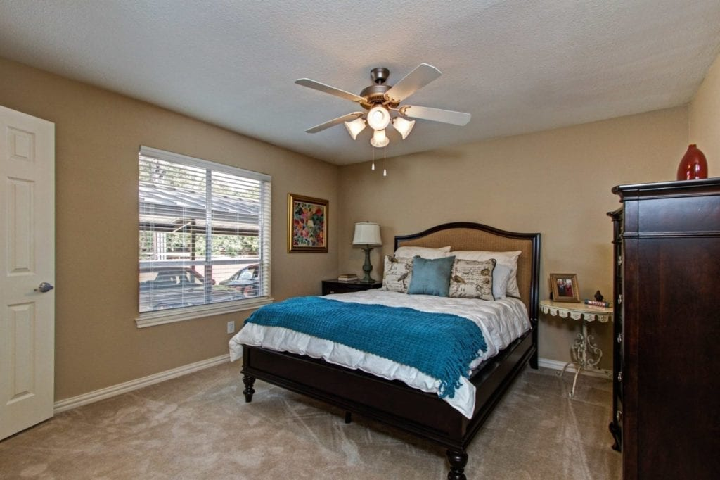 Typical apartment bedroom at the Active Adult Community Meadowstone Place in Dallas, TX