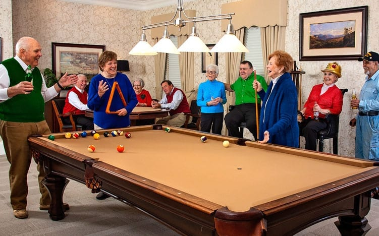 A group of senior residents hanging out at the recreation room of the Retirement Community Verena at the Reserve