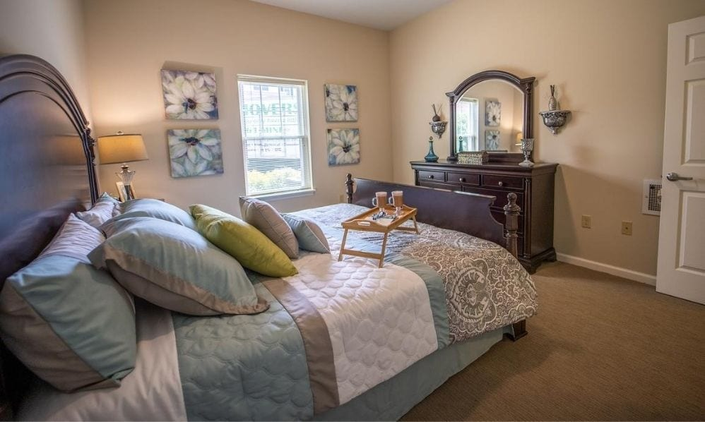 Typical apartment bedroom at the Senior Living Community Arbour Square of Harleysville, PA
