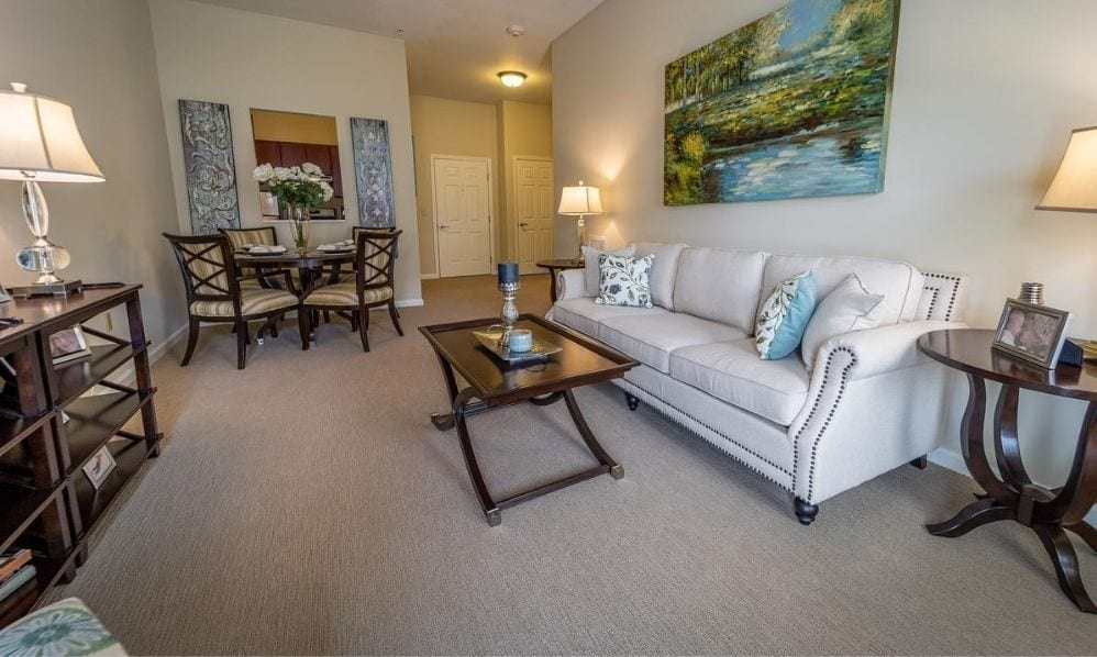 Typical apartment living room with dining area at the Senior Living Community Arbour Square of Harleysville, PA