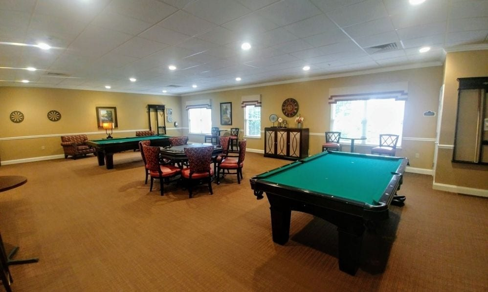 Recreation room with pool table of the Senior Living Community Arbour Square of Harleysville, PA