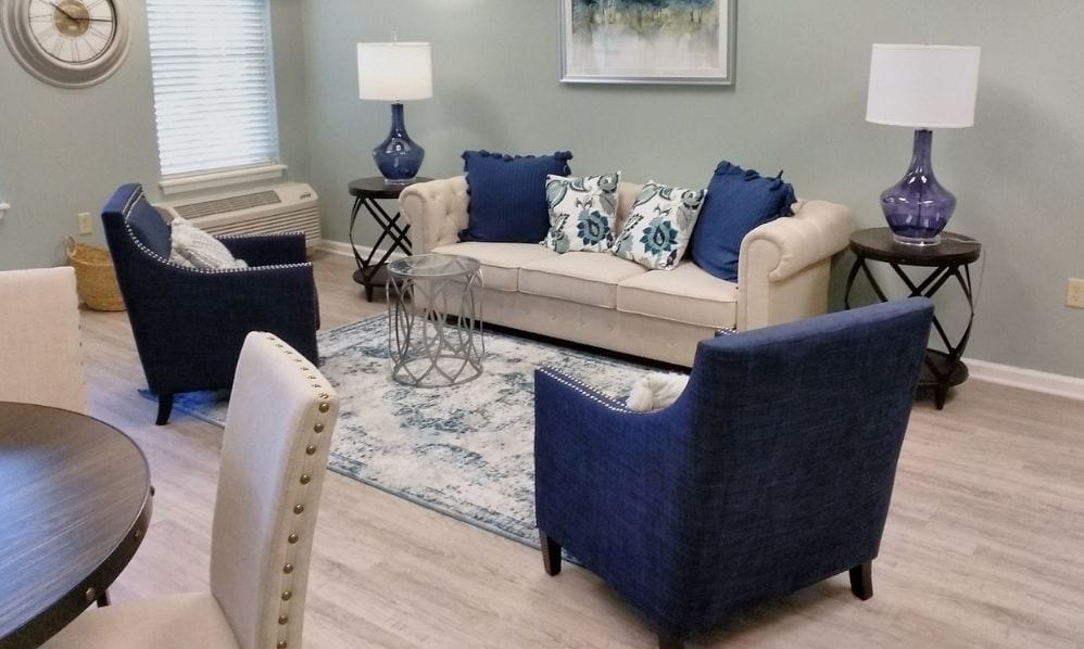 A bege and blue apartment living room of the Senior Living Community Arbour Square of Harleysville, PA