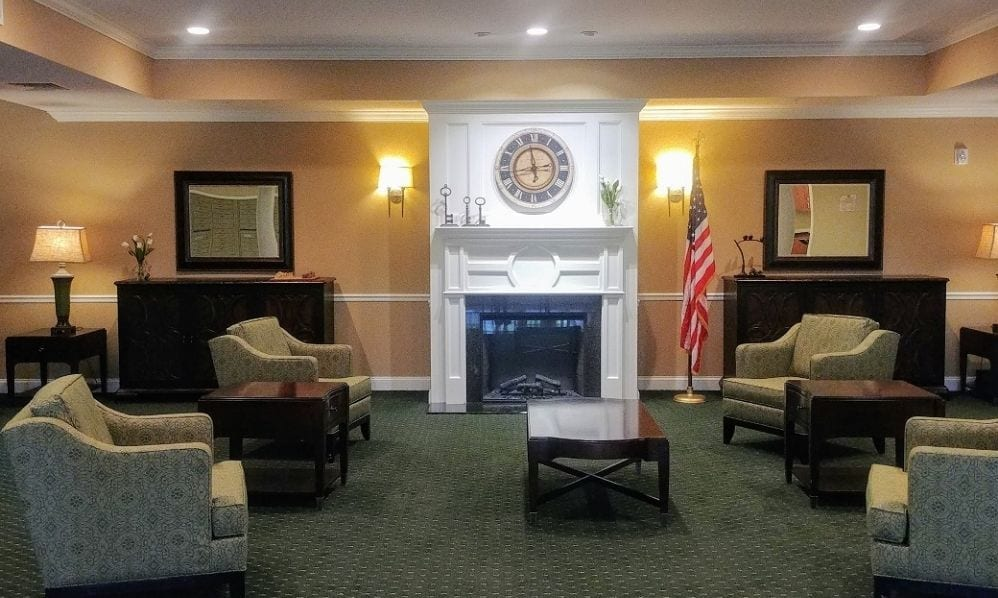 Relaxing area with fireplace at the Senior Living Community Arbour Square of Harleysville, PA
