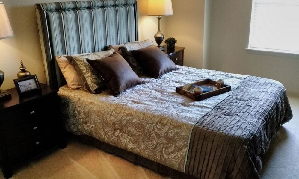A beautiful and dark apartment bedroom of the Senior Living Community Arbour Square of Harleysville, PA