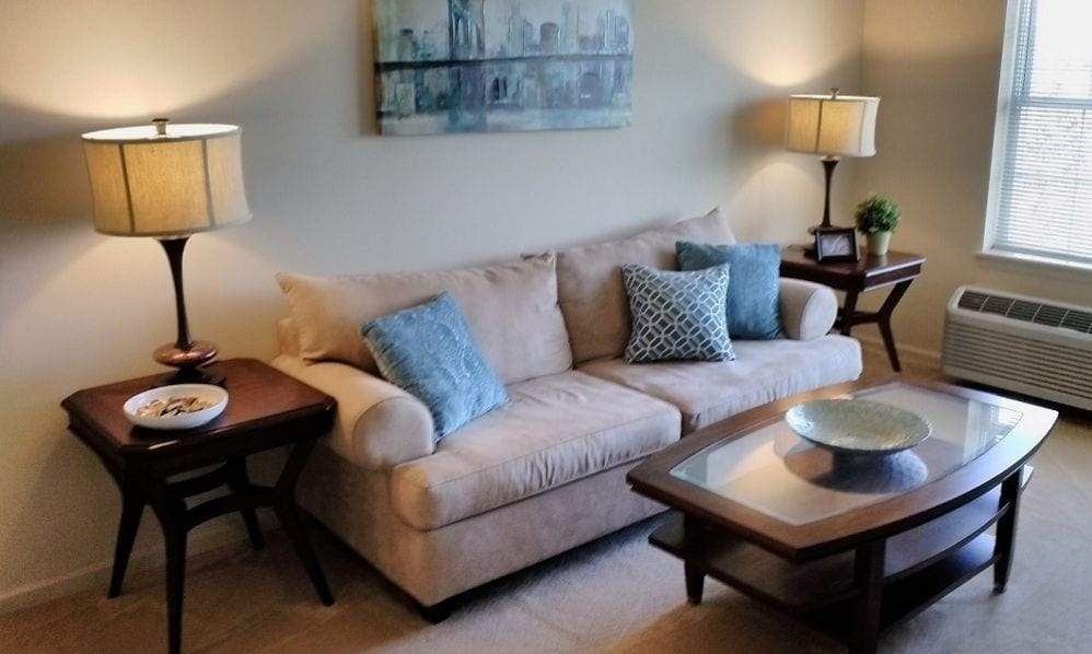A beautiful and blue apartment living room of the Senior Living Community Arbour Square of Harleysville, PA