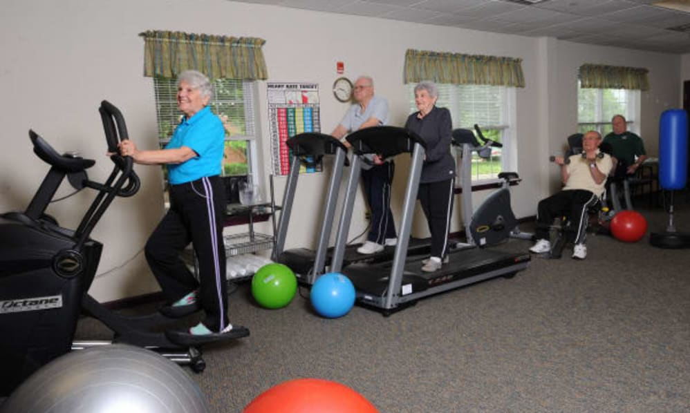 A group of senior residents exercising at the gym of the Senior Living Community Arbour Square of Harleysville, PA