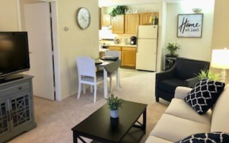Living room and kitchen of the Pine Ridge Villas of Shelby Independent Living apartment in Shelby Township, MI