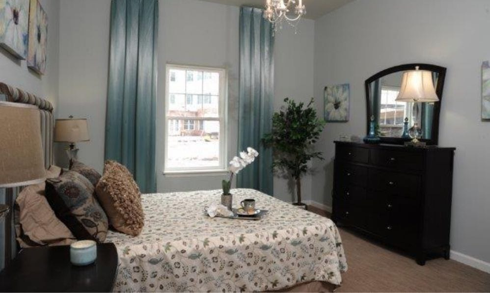 A beautiful and elegant apartment bedroom of the Senior Living Community Arbour Square of Harleysville, PA