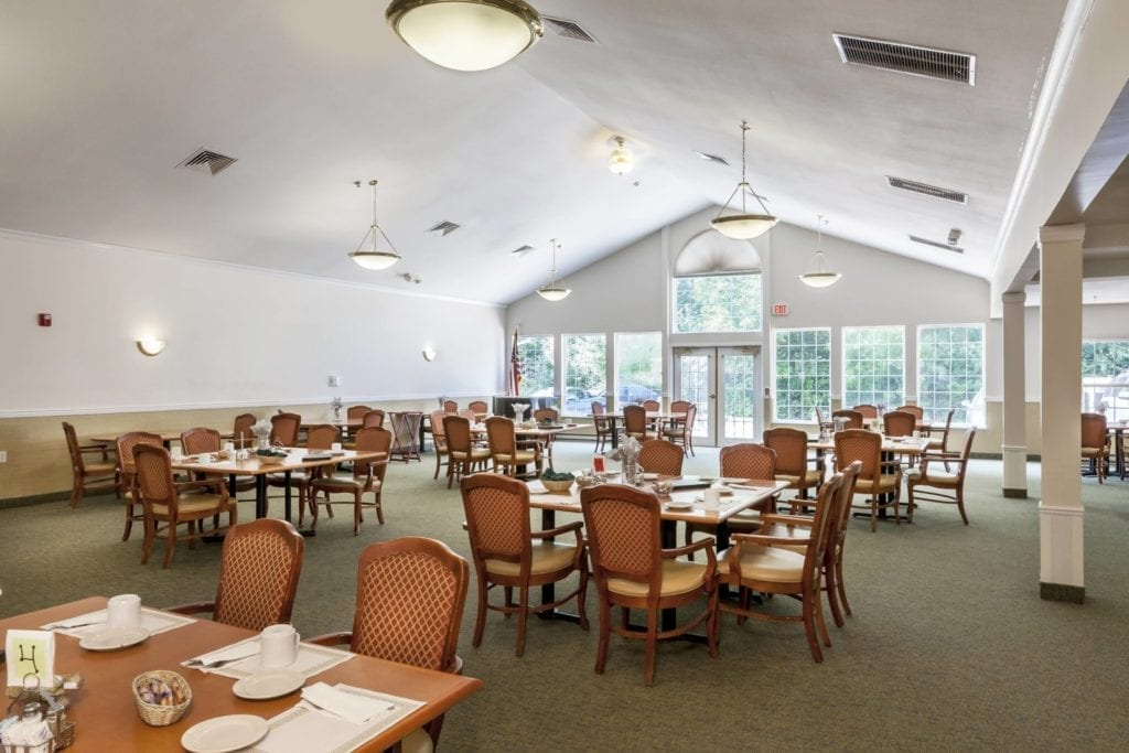 The common area dining room of Pine Ridge of the Plumbrook Senior Living in Sterling Heights, MI