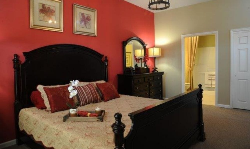 A red apartment bedroom of the Senior Living Community Arbour Square of Harleysville, PA
