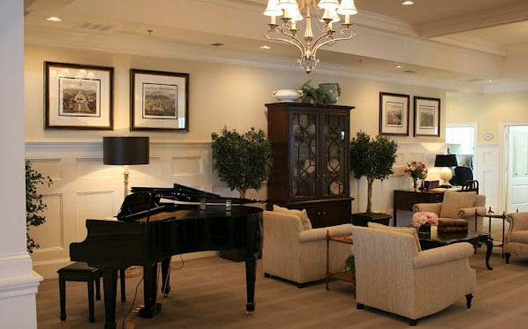 A piano in the lounge area at the Retirement Community Verena at the Reserve in Williamsburg, VA