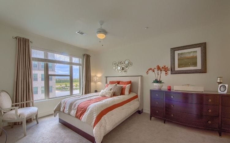 bedroom at skye luxury senior living retirement apartments in leander, texas