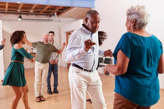 a group of senior people attending dance class